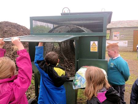 Young People from Severn View Primary Academy School examining the Jimmy Riddle compost sieving machine in a group workshop July 2016