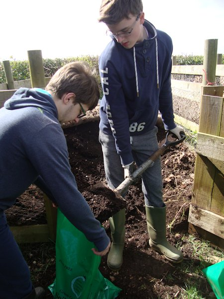 Horticultural students from Thomas Keble, our local secondary school, fill bags with leaf mould
